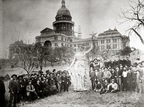 Photo of crowd with the Goddess of Liberty statue before it was placed atop the capitol dome.